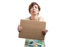 Woman with sad news on a card Royalty Free Stock Photos