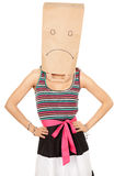Woman in sad paper bag on head Stock Photography