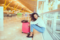 Woman sad and unhappy at the airport with flight canceled. N Royalty Free Stock Images