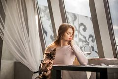 The woman is sad and is waiting for a meeting in the restaurant Royalty Free Stock Images