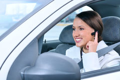Woman is safely talking phone in a car