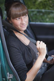 Woman with safety belt in car Royalty Free Stock Images