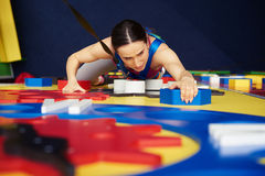 Woman in safety belt in climbing on the wall Stock Image
