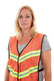 Woman in safety vest. Over white background stock image