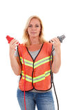 Woman in safety vest Royalty Free Stock Image