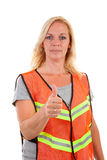 Woman in safety vest. With thumb up over white background stock image