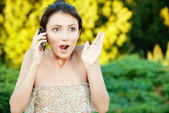Woman said by cell phone Stock Image