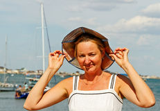 Woman at the sailboat. Stock Photo