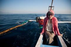 Woman sailing Stock Images