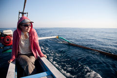 Woman sailing Stock Images