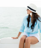 Woman sailing in a boat Stock Photo