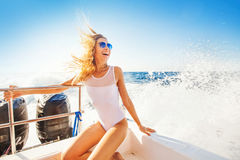 Woman sailing a boat in a paradise island Stock Images