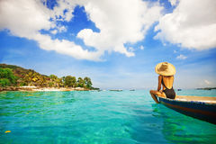 Woman sailing a boat in a paradise island Royalty Free Stock Photo