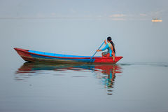 A woman sailing a boat in Pokhara,Nepal Royalty Free Stock Photos