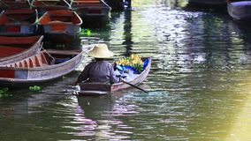 Woman sailing domestic wood boat in dumneon saduak canal most popular traveling destination in ratchaburi thailand stock video