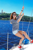 Woman sailing on a yacht in fashionable sunglasses. View of Kiev, the Dnieper River Stock Images