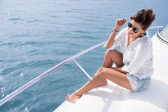 Woman sailing in a yacht Stock Photos