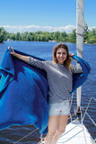 Woman sailing on a yacht. Sail boat. sailor girl on a yacht Royalty Free Stock Images