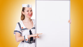 Woman sailor with blank board against the gradient Stock Images