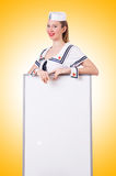 Woman sailor with blank board Royalty Free Stock Photo