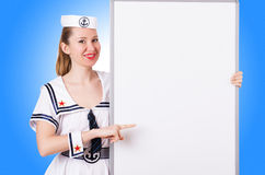 Woman sailor with blank board Stock Image