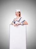 Woman sailor with blank board on the white Royalty Free Stock Images