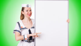 Woman sailor with blank board on the white Stock Images