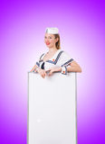 Woman sailor with blank board on white Stock Photos