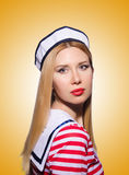Woman in sailor costume  - marine concept. The woman in sailor costume  - marine concept Stock Photography