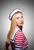 Woman in sailor costume  - marine concept. The woman in sailor costume  - marine concept Stock Photos
