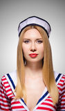 Woman in sailor costume  - marine concept. The woman in sailor costume  - marine concept Royalty Free Stock Photography