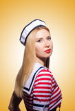 Woman in sailor costume  - marine concept. The woman in sailor costume  - marine concept Royalty Free Stock Photo