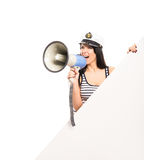 A woman in a sailor hat screaming with a megaphone Stock Images