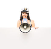 A woman in a sailor hat screaming with a megaphone Stock Photos