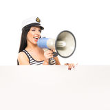 A woman in a sailor hat screaming with a megaphone Royalty Free Stock Photography