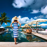 Woman sailor striped in dress near poolside Stock Image
