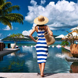 Woman sailor striped in dress near poolside. Woman in sailor striped dress near poolside jetty at Seychelles Stock Images