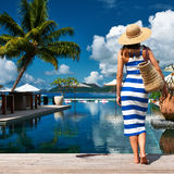Woman sailor striped in dress near poolside Stock Photo