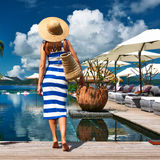 Woman sailor striped in dress near poolside Royalty Free Stock Images