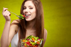Woman with salad Stock Photography