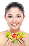 Woman with salad. Closeup portrait of an beautiful asian young woman with a bowl of salad Royalty Free Stock Images