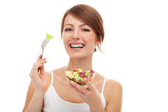 Woman with salad on fork, isolated Royalty Free Stock Photography