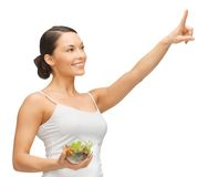 Woman with salad. Woman holding salad and working with something imaginary stock image