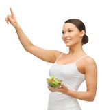 Woman with salad. Woman holding salad and working with something imaginary stock photo