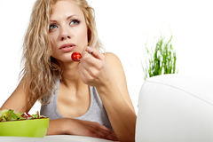 Woman with salad at home Stock Photos