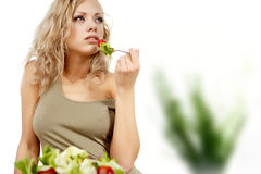 Woman with salad at home Stock Images
