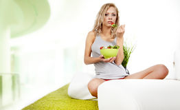 Woman with salad at home Stock Photo