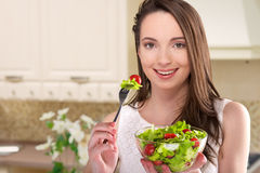 Woman with salad in kitchen Royalty Free Stock Photography