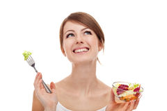 Woman with salad looking up. Royalty Free Stock Photography