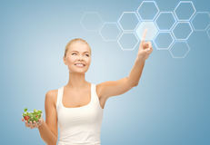 Woman with salad and virtual screen Stock Image